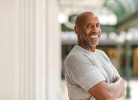 Confident man with dental implant in Clinton Township smiling