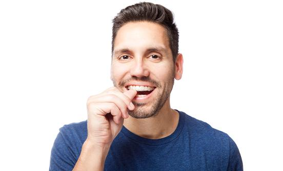 Man placing clear aligner