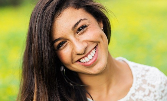 Woman with beautiful smile outdoors