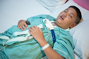 child wearing sleep apnea device