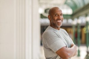 Smiling, confident man with dental implants