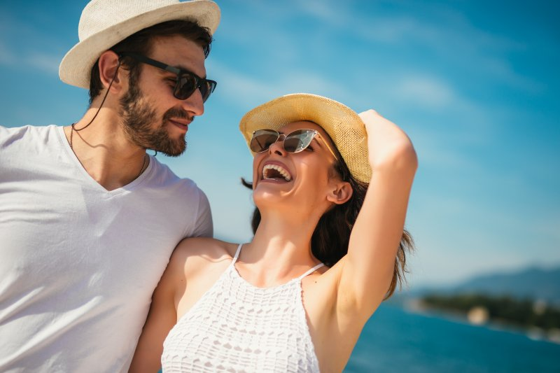 Couple smiling while on summer vacation